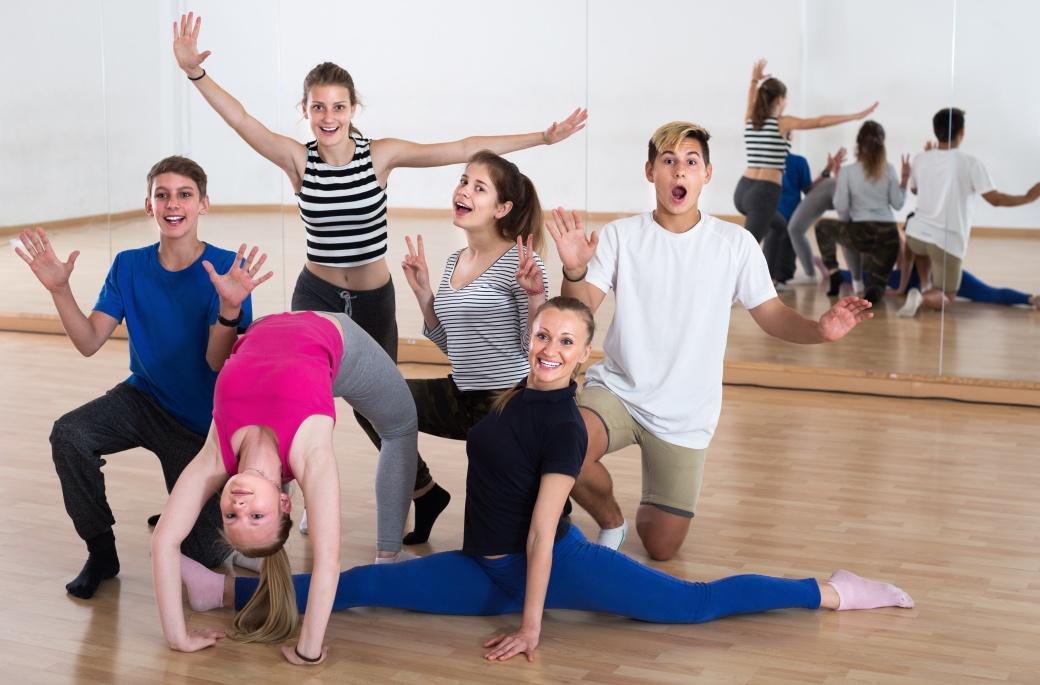 Group of students dancers in dance studio smiling